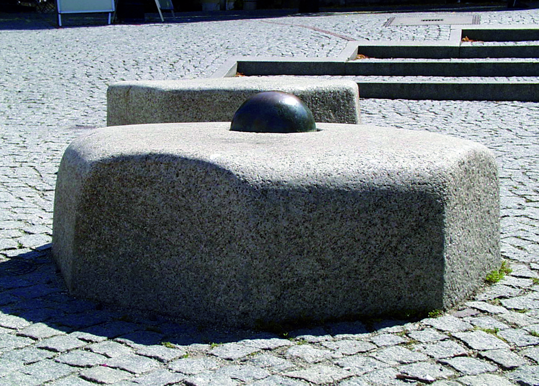 Photo: octagonal granite kerbstones in front of the Dachau town hall