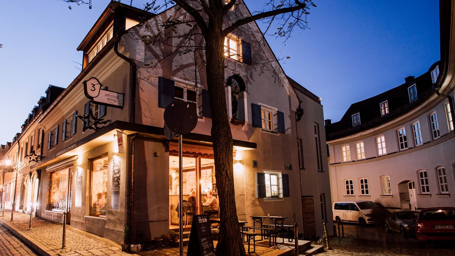 A café in the old town of Dachau, illuminated at the blue hour