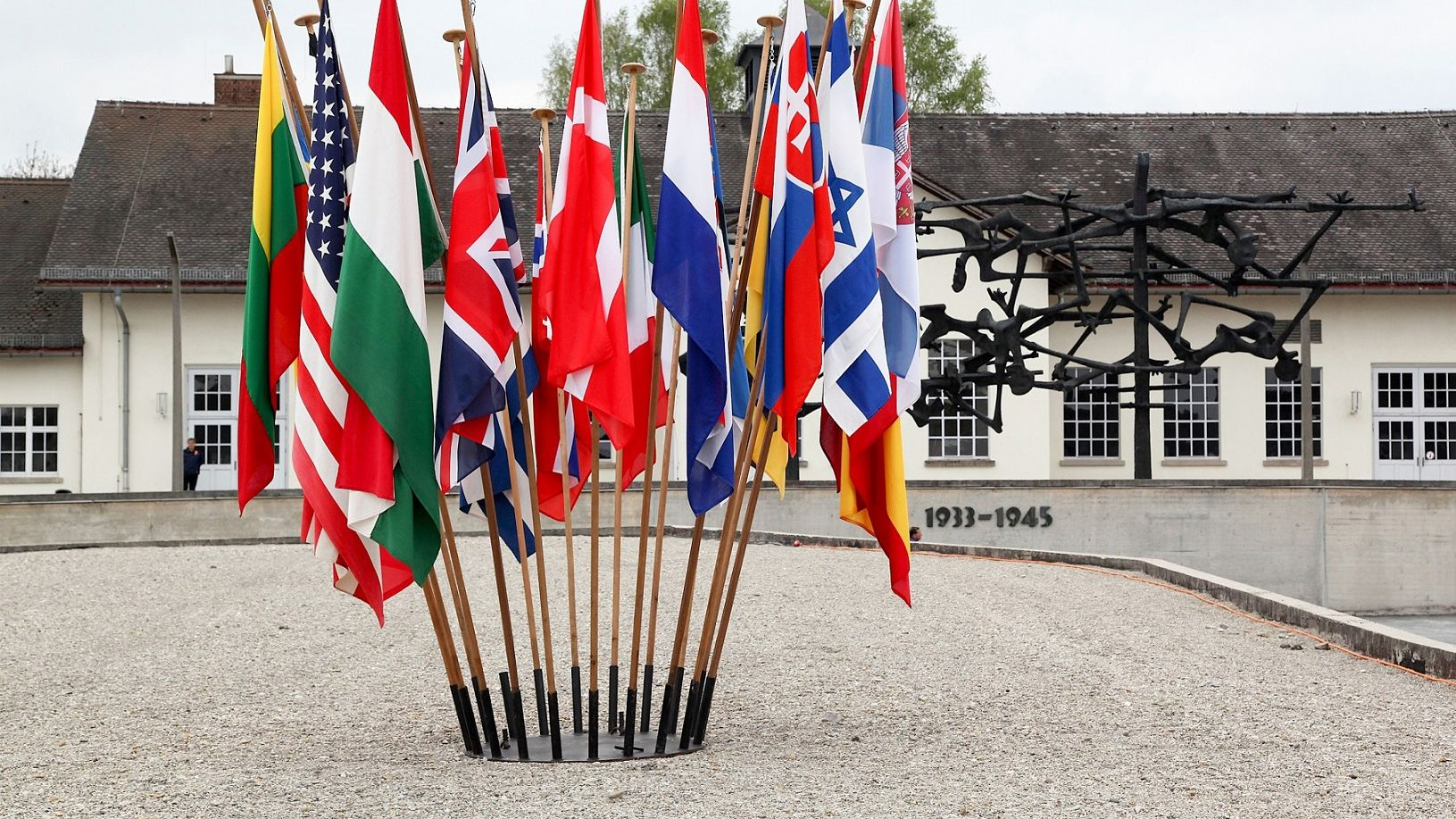 Photo of International Memorial at Concentration Camp Memorial Site Dachau with Nation Flags in front, photo: City of Dachau