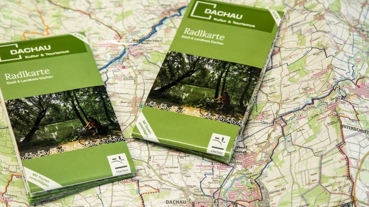[Translate to English:] Photo of 2 cycle maps Dachau and district Dachau on unfolded cycle map